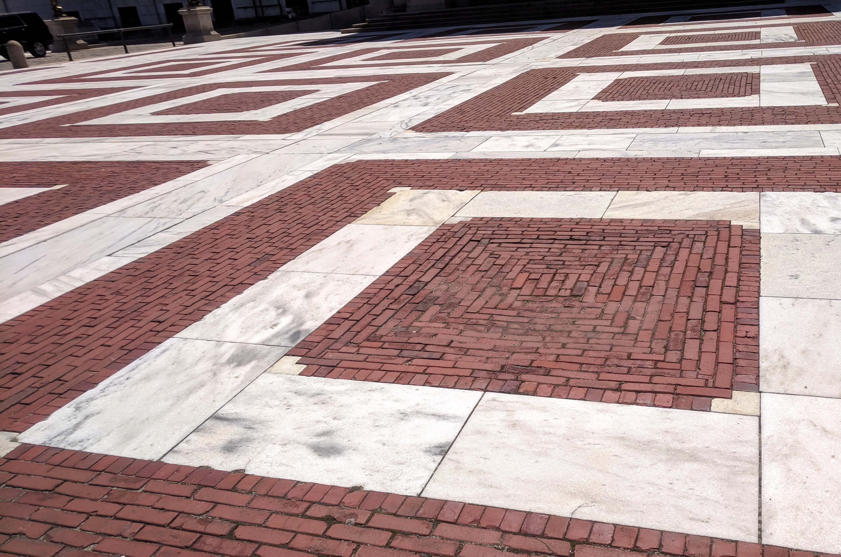 red brick and white marble designs on plaza
